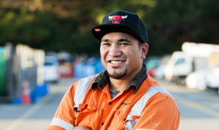 Smiling, male construction worker